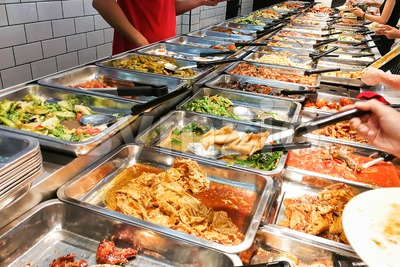 People picking food at Chinese economy rice stall in Malaysia Stock Photo