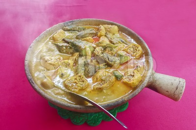 Clay pot fish head curry Chinese style popular delicacy in Malaysia Stock Photo