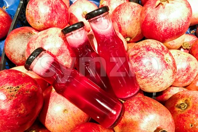 Fresh cold pressed organic pomegranate juice against pomegramate fruits Stock Photo