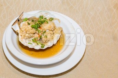 Steamed fresh scallop with clamp shell in Chinese meal Stock Photo