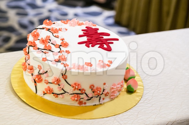 Decorated birthday cake celebration for eldery person with Chinese word Longevity