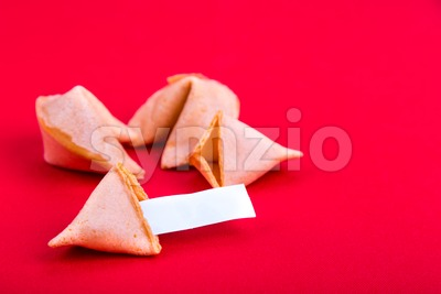 Fortune cookies with blank predictive label on red background Stock Photo