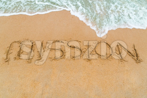 MISSION inscription written on sandy beach with wave approaching Stock Photo