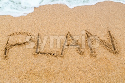 PLAN inscription written on sandy beach with wave approaching Stock Photo