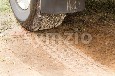 Four wheel drive tire with tracks on dry dirt road Stock Photo
