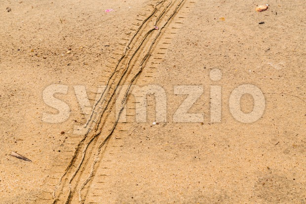 Tire tracks on dry brown yellow dirt road Stock Photo