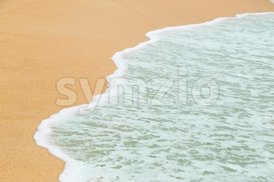 Calm sea waves breaking on sandy beach as background resources Stock Photo