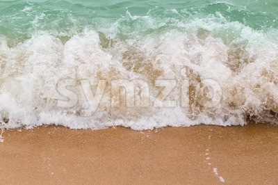 Sea waves breaking on sandy beach as background resources Stock Photo