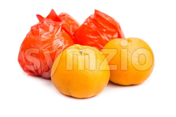 Mandarin oranges with plastic protective wrapper isolated in white Stock Photo