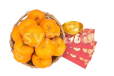 Mandarin oranges, gold nugget, red packets with good luck character Stock Photo