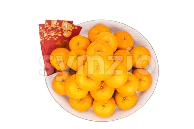Heap of mandarin oranges, red packets with good luck character Stock Photo