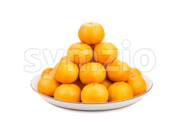 Stack of mandarin oranges in tray with white background Stock Photo