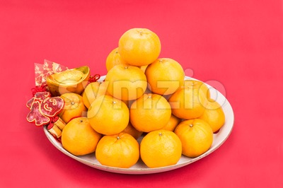 Mandarin oranges, gold nuggets, red packets, Chinese good luck word Stock Photo