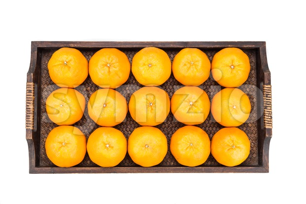 Juicy mandarin oranges in tray with white background Stock Photo