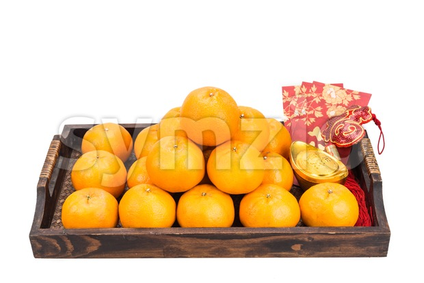 Mandarin oranges,  gold nuggets, red packets with good luck character Stock Photo