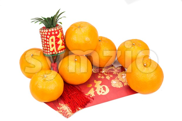 Mandarin oranges and red packets with Chinese good luck character Stock Photo