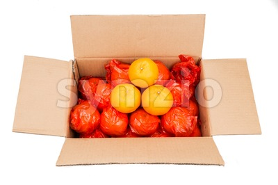 Mandarin oranges  in carton box with plastic wrapper for protection Stock Photo