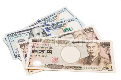 Close up of Japanese Yen currency note against US Dollar. Stock Photo