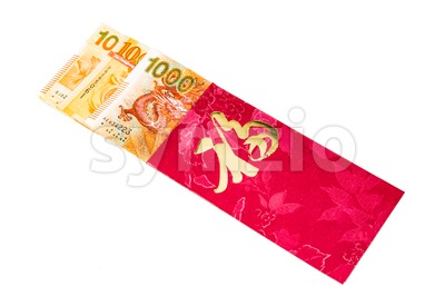 Red packet with Good Fortune character contains Hong Kong Dollars Stock Photo