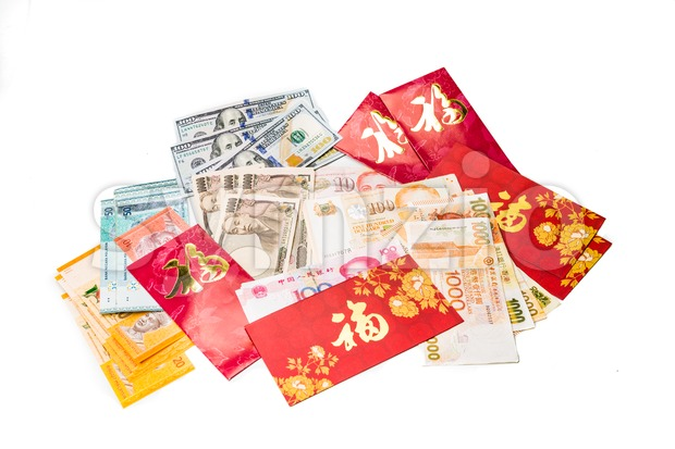 Red packets with Good Fortune character and various currency notes Stock Photo