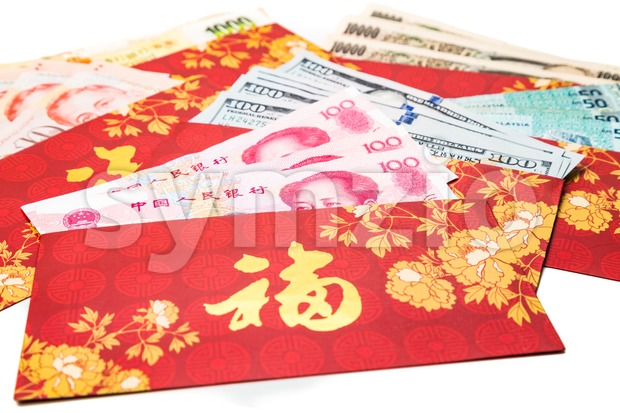 Hung Bao or red packet with Good Fortune Chinese character scatted with various currency notes