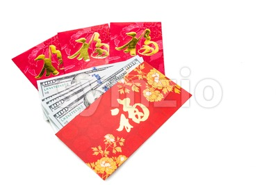 Red packet with Good Fortune Chinese character contains US Dollars Stock Photo