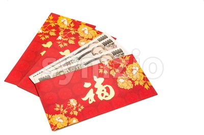 Red packet with Good Fortune character contains Japanese Yen currency Stock Photo