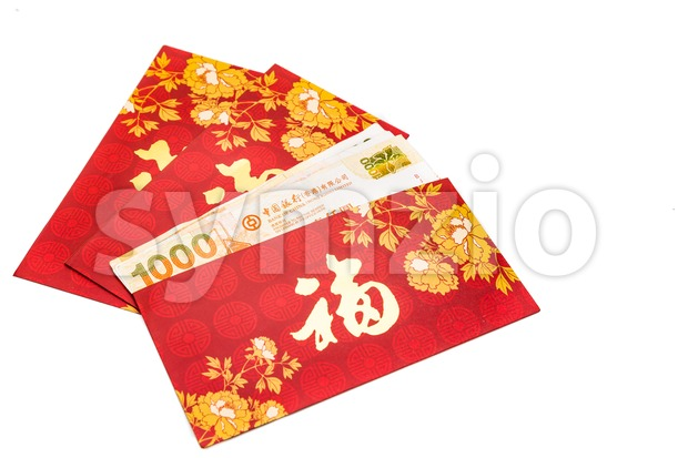 Hung Bao or red packet with Good Fortune Chinese character filled with Hong Kong Dollars