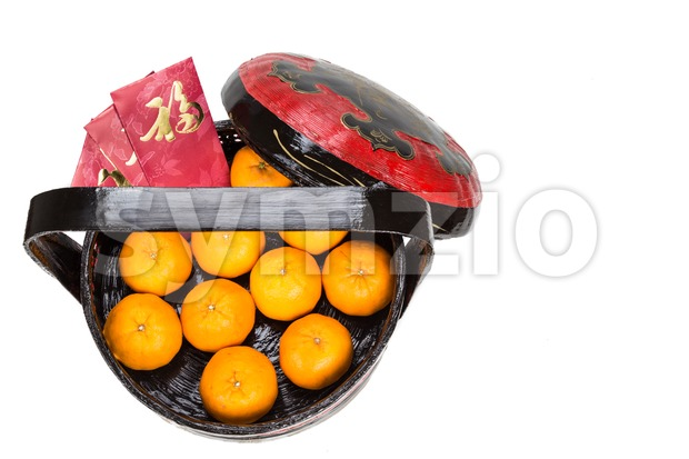 Mandarin oranges in basket with red envelope Good Luck character Stock Photo