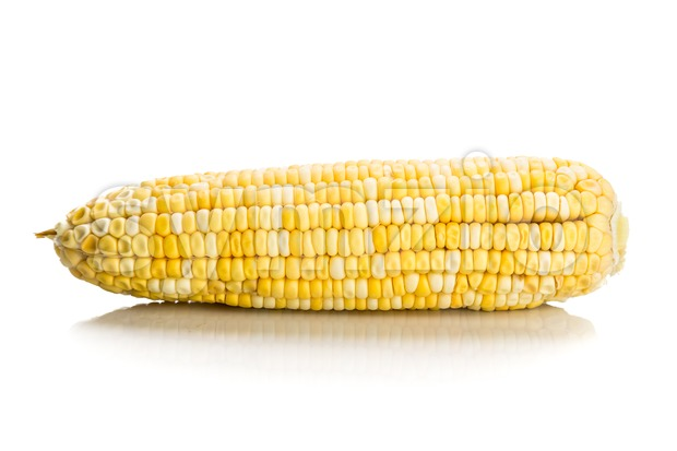 Fresh corn maize cob with kernel seeds without husk Stock Photo