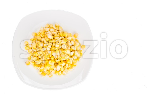 Overhead view of fresh corn maize kernels on plate Stock Photo