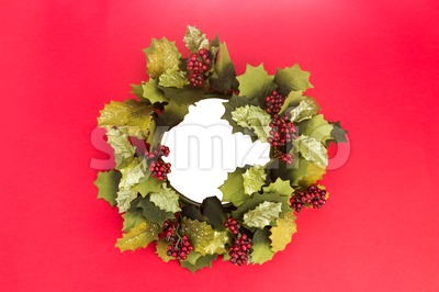 Beautiful round Christmas garland with isolated center on red background. Stock Photo