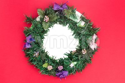 Beautiful round Christmas garland on red background. Stock Photo