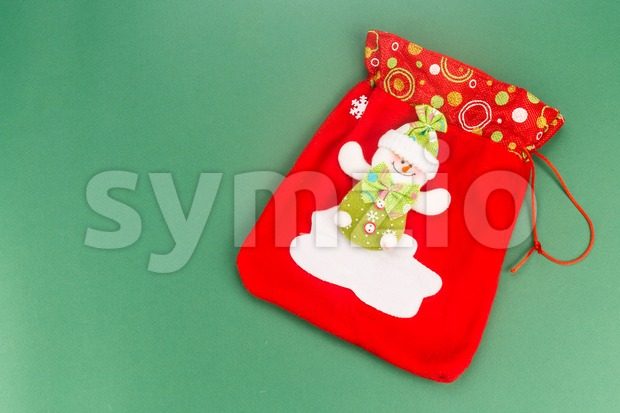 Pretty Red Santa Clause bag with green background. Stock Photo