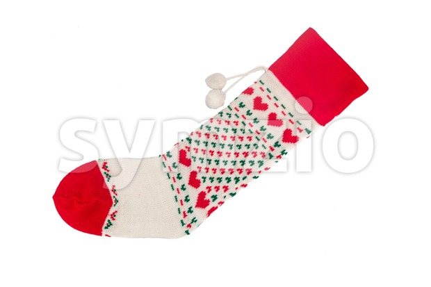 Christmas socks with heart shaped stitches in green background. Stock Photo