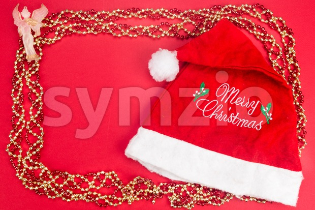 Beautiful ornaments framed Christmas decoration in red background