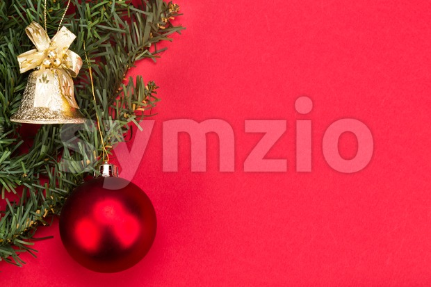 Simple red Christmas background with fir tree,  ornaments and bell