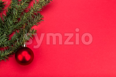 Simple red Christmas background with fir tree and ornaments. Stock Photo