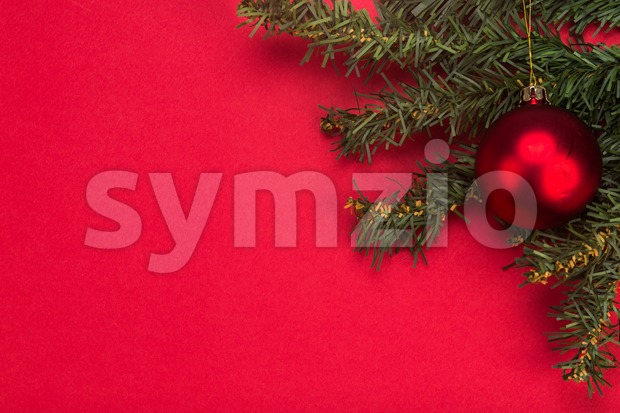 Simple red Christmas background with fir tree and ornaments