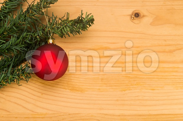 Simple wooden Christmas background with fir tree and ornaments