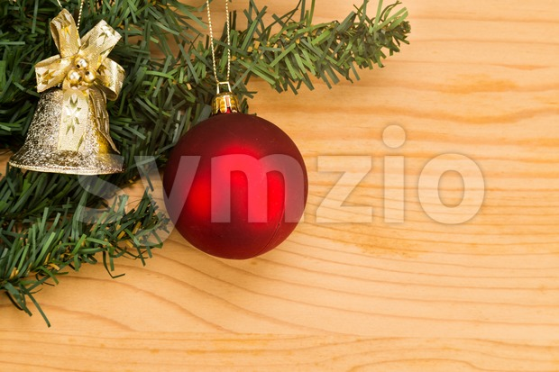 Simple wooden Christmas background with fir tree, ornament and bell