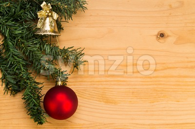 Simple wooden Christmas background with fir tree, ornament and bell. Stock Photo