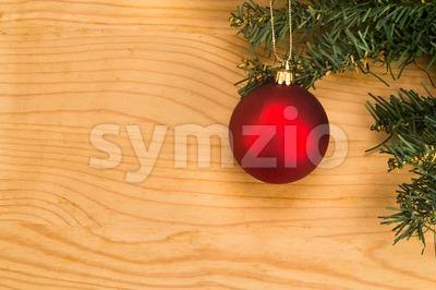 Simple wooden Christmas background with fir tree and ornaments. Stock Photo