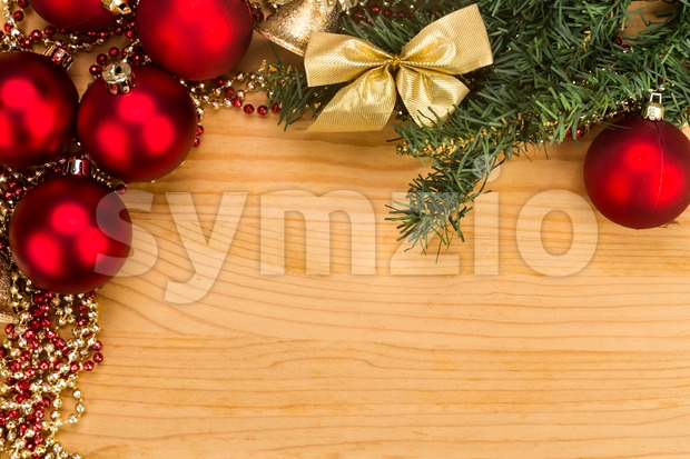 Simple wooden Christmas background with fir tree, ornaments and bells