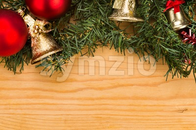 Simple wooden Christmas background with fir tree, ornaments and bells. Stock Photo