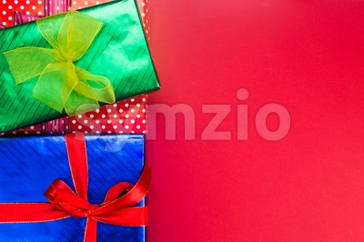 Colourful Christmas background decorated with gift boxes and ribbons. Stock Photo