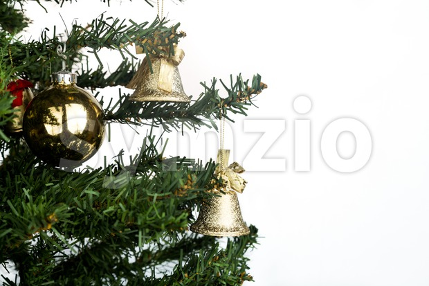 White Christmas background with fir tree and gold ornaments. Stock Photo