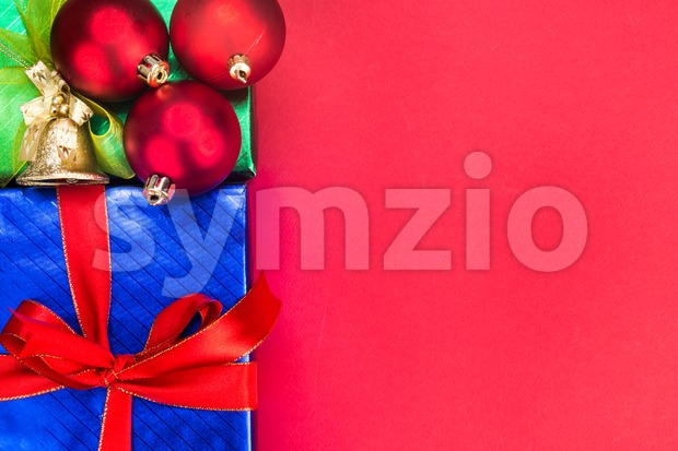 Colourful Christmas background decorated with gift boxes and ribbons