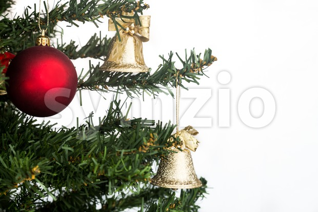 White Christmas background with fir tree and red, gold ornaments. Stock Photo