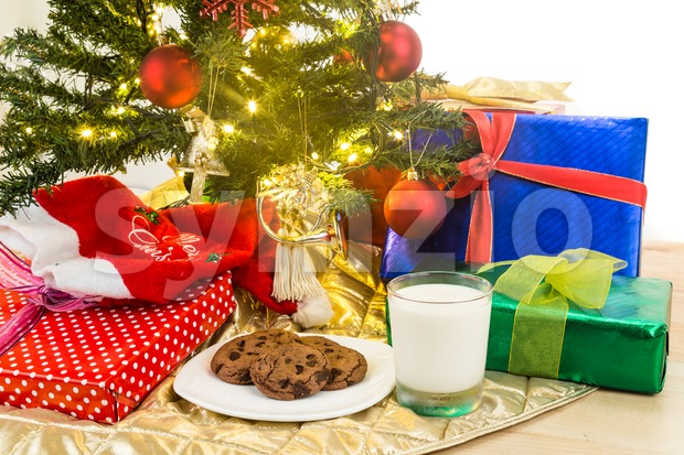 Milk and cookies for Santa Clause under Christmas tree. Stock Photo